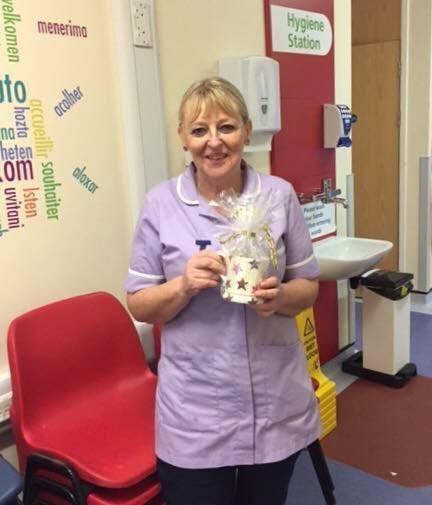 A lovely Nurse getting the Star of the Month Award
